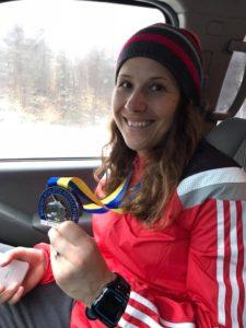 Susanne showing off her 2018 Boston Marathon medal!